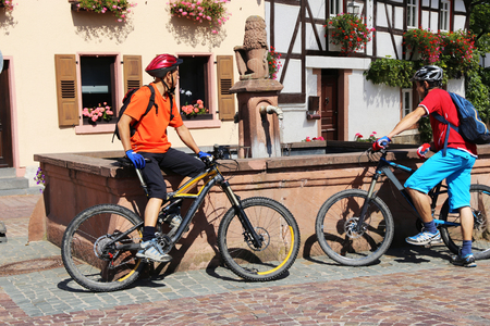 Mountain bikers resting on a wells