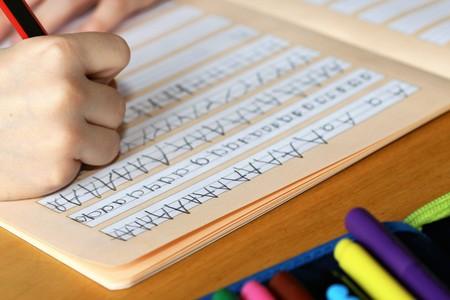 Photo pour First grader learns writing - image libre de droit