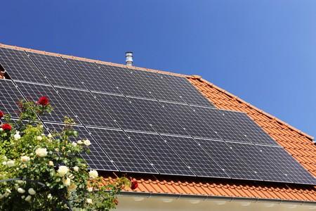 Photo pour Roof with solar panels (photovoltaics) - image libre de droit