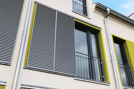 Foto de Windows with modern sliding shutters - Imagen libre de derechos