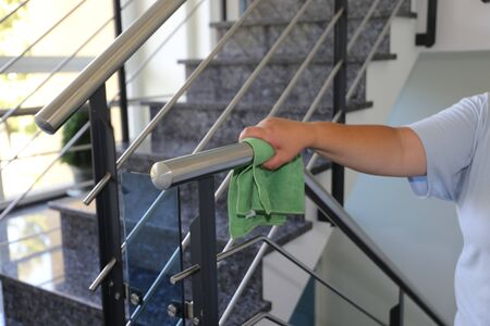 Photo pour Professional staircase cleaning in a building - image libre de droit