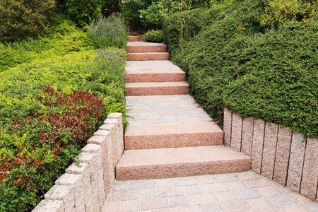 Photo for Neat and tidy front yard with solid block steps, decorative gravel and planting - Royalty Free Image