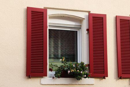 Photo pour Window with red wooden shutter - image libre de droit