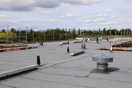 Photo pour Professional flat roof sealing of a large roof - image libre de droit