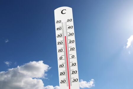 Photo for Symbol image: Thermometer in front of blue sky shows warm temperatures - Royalty Free Image