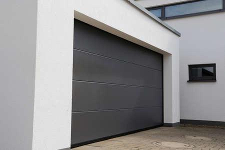 Foto de Modern new garage door (sectional door) - Imagen libre de derechos