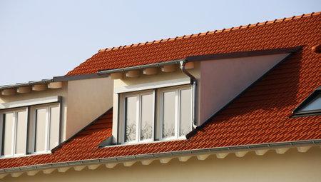 Photo pour Large dormer on a newly tiled roof - image libre de droit