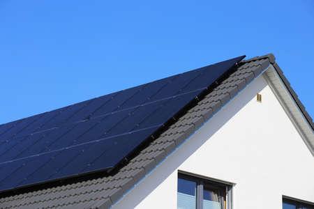 Photo pour Single family house with solar system or photovoltaic system - image libre de droit