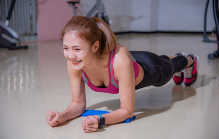 Photo for Asian woman exercising in the gym, She was pretending to - Royalty Free Image