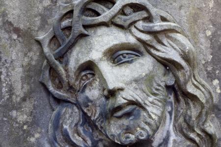 Closeup of Jesus Christ on old grunge grave
