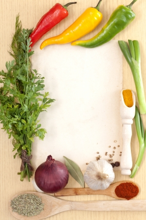 Vegetables and spices border and blank paper for recipesの写真素材