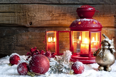 Christmas baubles and lantern in night vintage background