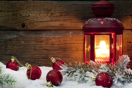 Christmas lantern with baubles on snow vintage background