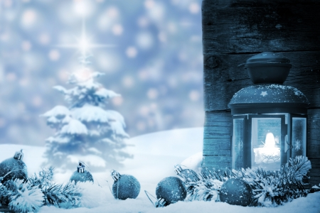 Christmas baubles with lantern snow and tree background concept
