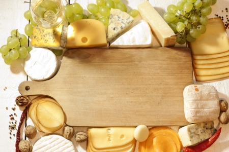 Various types of cheese with empty space background conceptの写真素材