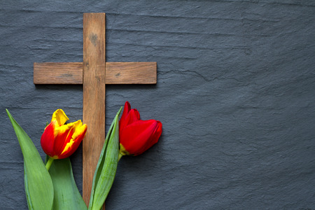 Photo for Abstract easter tulips and wooden cross on black marble - Royalty Free Image
