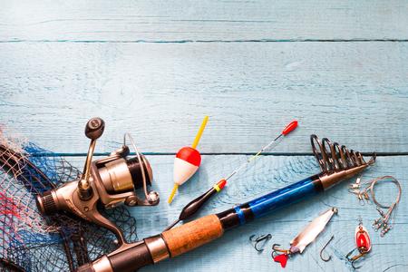 Photo pour Fishing tackle on wooden blue background - image libre de droit