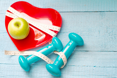 Fit and health abstract concept with red heart plate