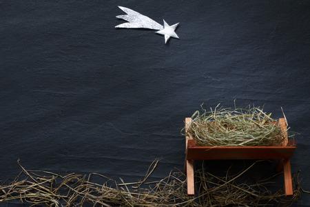 Foto de Manger and star of Bethlehem abstract Christmas  nativity scene on black marble - Imagen libre de derechos