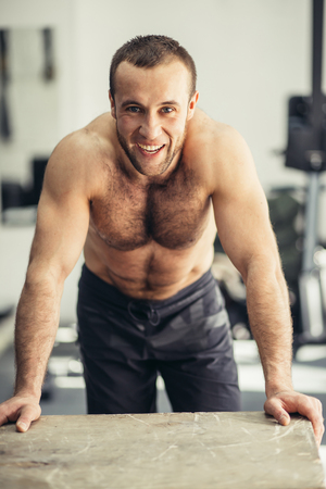 Physically Fit Man posing In A Health Club