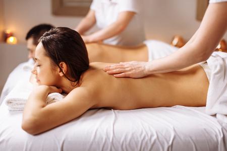 Foto de Happy couple getting massage at spa - Imagen libre de derechos