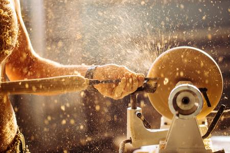Wood lathe. Carpenter lathing wood