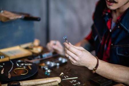 Photo pour professional artisan dealing with material, close up cropped photo. business - image libre de droit