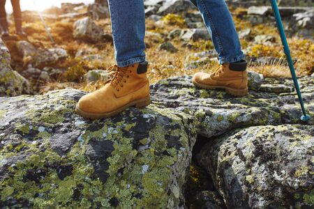 male boots on summer nature trail, grand canyon background. Active lifestyle adventure gear concept.lifestyle