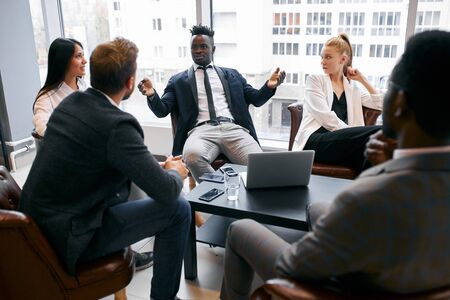 Photo pour Confident business partners gathered in office to discuss interesting joined business ideas, share business ideas - image libre de droit