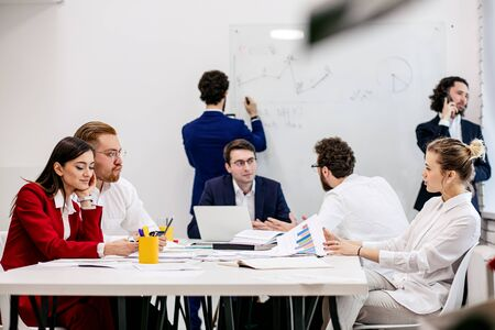 Photo pour business co-working in modern office, young leaders, partners use laptop, documents, discuss business strategies together, planning work for future year - image libre de droit