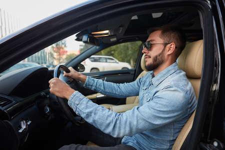 Photo pour cool driver is in the fashion car. closeup side view photo. occupation, profession concept - image libre de droit