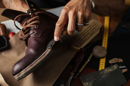 Photo pour Shoe or belt maker working place at leather workshop with cobbler s and craft tools on background - image libre de droit