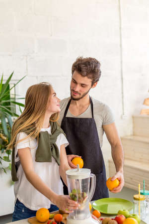 Photo for young people are enjoying themselves during cooking. close up shot. - Royalty Free Image