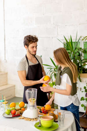 Photo for young cheerful man is offering to a girl to grab a bite. close up photo - Royalty Free Image