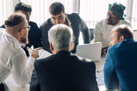 Photo pour startup business, serious multiethnic business people of different age and races gather in meeting room in white modern office interior. - image libre de droit