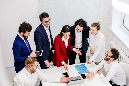 Photo pour active discussion, co-working of young business partners or colleagues in modern office, wearing formal wear, enjoy working together, brainstorm time - image libre de droit