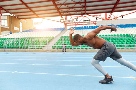 Foto per shirtless man running in the track., side view photo, copy space ,man working out at the stadium, challenge - Immagine Royalty Free