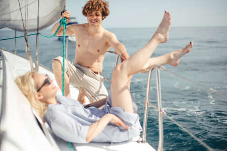Photo pour Loving couple spending happy time on a yacht at sea. Luxury vacation on a seaboat. - image libre de droit