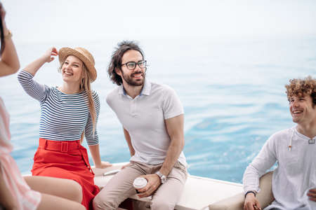 Photo pour Caucasian attractive just married couple having their honeymoon trip on a luxury sailing boat at summer Carribean Sea - image libre de droit