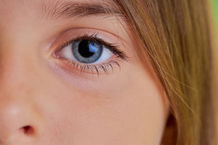 Photo for close-up photo of little girls blue eyes, macro photo of childs eyes, look at camera. natural beauty, fresh skin concept - Royalty Free Image