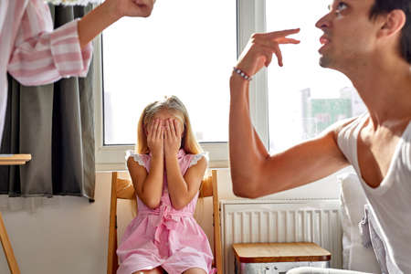 Photo pour daughter is tired of family conflicts,divorce and children concept. little kid girl sit upset with quarrelling of parents, they are going to be divorced - image libre de droit
