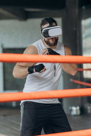 Photo for Boxer man with vr glasses fighting in simulated virtual reality - Royalty Free Image