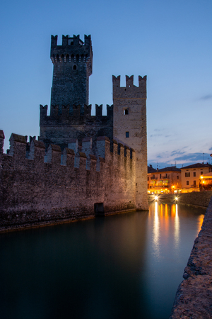 Photo pour The Scaligero Castle, building started in 1259, is a rare example of medieval port fortification, which was used by the Scaliger fleet. - image libre de droit
