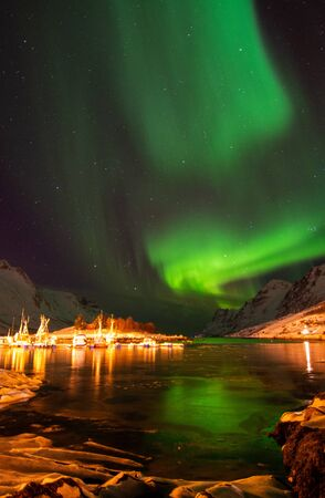 Photo for An aurora borealis, sometimes referred to as polar lights or northern lights, is a natural light display in the Earth's sky, predominantly seen in the high-latitude regions. - Royalty Free Image