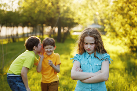 Photo pour Little girl offended after quarrel to his brothers. - image libre de droit