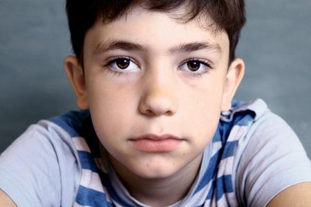 oy close-up face  portrait on blue background