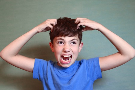 Photo for preteen handsome boy scratch his head isolated on blue - Royalty Free Image