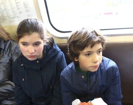 teen boy and girl in underground train close up photo