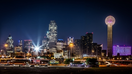 Dallas skyline by night with the Bank of America and Reunion Tower among other skyscrapers in Dallas, USA