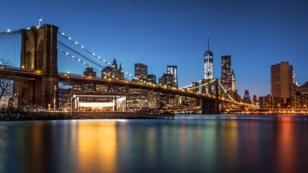 Brooklyn Bridge at dusk viewed from the Brooklyn Bridge Park in New York City